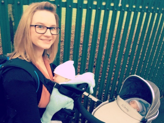 Twin mum and baby twins. Baby twins out for a walk in tandem pram