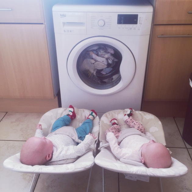 Babies entertained by washing machine