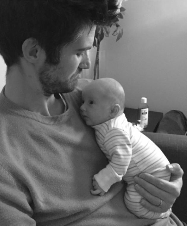 Daddy cuddling baby twin