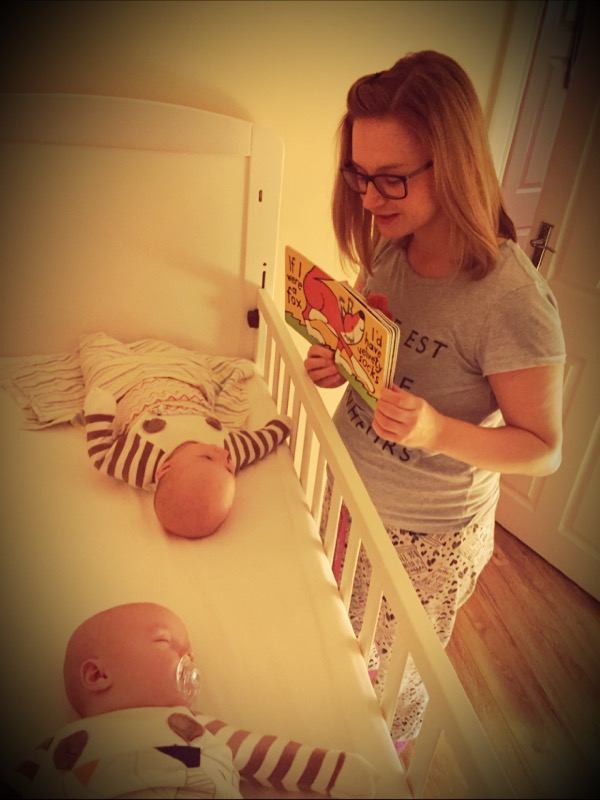 Mum reading to baby twins. Baby twins bed time routine. reading to babues
